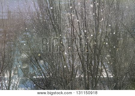 Blurred background of snowfall in the city