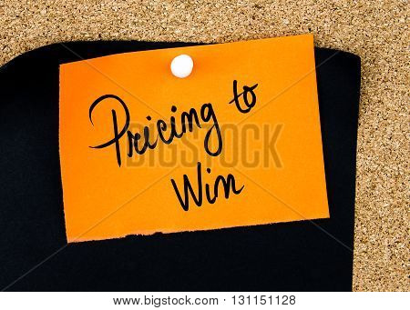 Pricing To Win Written On Orange Paper Note