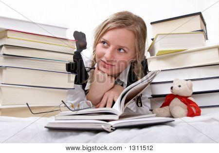 Schoolgirl Or Student Reading Books