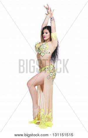 Young beautiful exotic eastern women performs belly dance in ethnic dress. Isolated on white background. Studio shot
