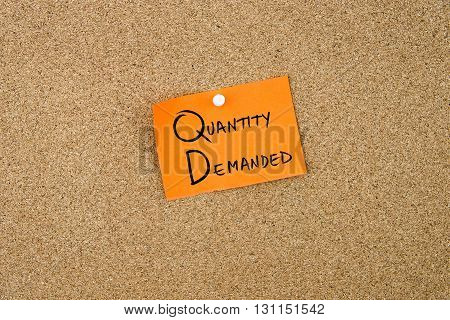Quantity Demanded Written On Orange Paper Note