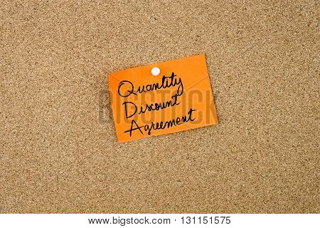 Quantity Discount Agreement Written On Orange Paper Note