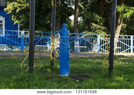 Old standpipes blue on a city street