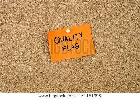 Quality Flag  Written On Orange Paper Note