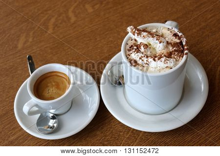 in a cup on the table strong coffee and cappuccino