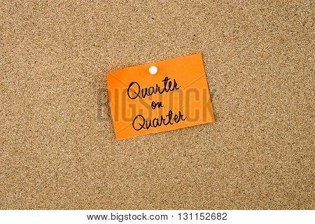 Quarter On Quarter Written On Orange Paper Note