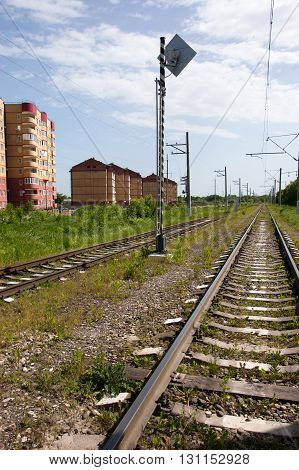 modern multi storey buildings along railroad tracks