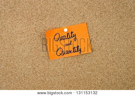 Quality And Quantity Written On Orange Paper Note