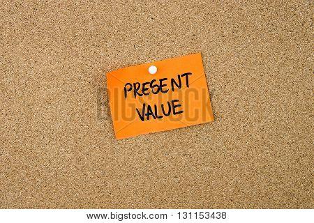 Present Value Written On Orange Paper Note