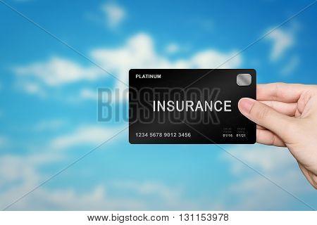 hand picking insurance platinum card on blur background