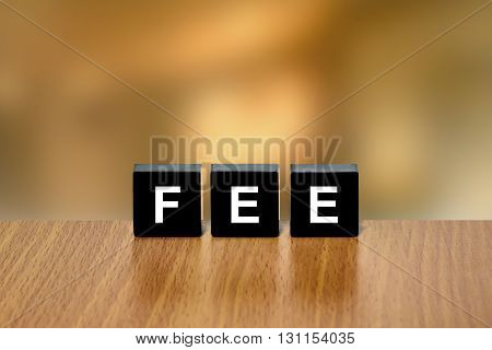 financial fee on black block with blurred background