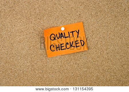 Quality Checked Written On Orange Paper Note