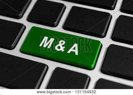 M&A or mergers and acquisitions green button on keyboard business concept
