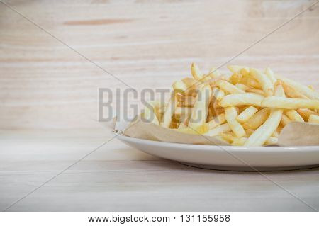 Homemade french fries potatoes on wood surface. french fries. Salted french fries.