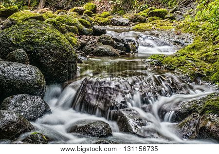 River in Costa Rica Flowing Through the Rocks
