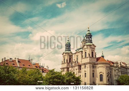 St. Nicholas Church in the Old Town of Prague, Czech Republic. Vintage, sunny blue sky