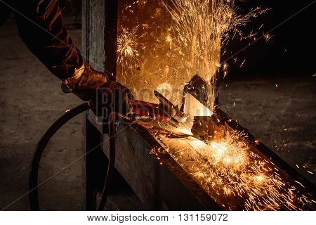 Gouging welding steel structure and bright sparks in factory