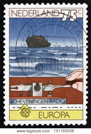 NETHERLANDS - CIRCA 1979: a stamp printed in Netherlands shows Hand on Morse Key and Ship at Sea circa 1979