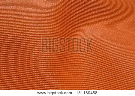 Orange rubber mat . Mat for fitness and tourism.
