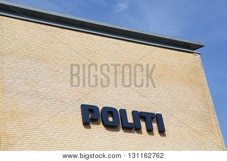 Horsens, Denmark - May 22, 2016: Danish police sign on a wall. The police of Denmark called politi in danish is the interior part of the Danish legitimate force providers