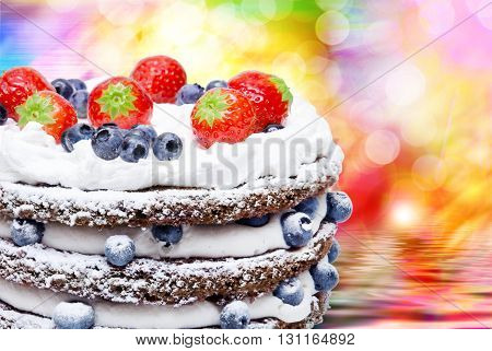 Birthday fruit cake with fruits close up