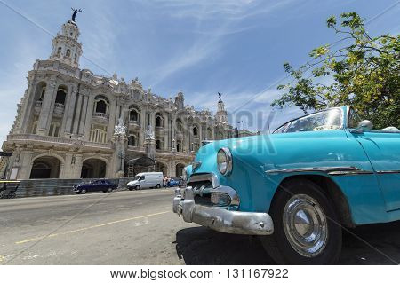 Havana, Cuba - June 22, 2015: A blue old american car, serving as taxi for tourists in front of the Gran Teatro in Old Havana