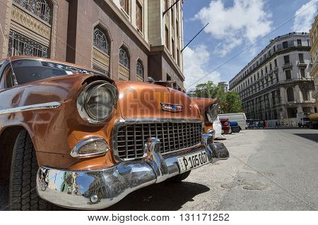 Havana, Cuba - June 22, 2015: Closeup of a classic american car parked in front of the Bacardi Building in Old Havana