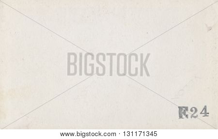 Old faded stained stamped paper texture background