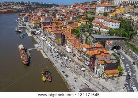 PORTO, PORTUGAL - APRIL 20, 2016: Promenade along the Ribeira in Porto, Portugal
