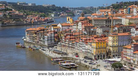 PORTO, PORTUGAL - APRIL 20, 2016: Panorama of the colorful houses of the Ribeira in Porto, Portugal
