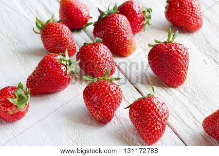 fresh sweet strawberry on light wooden background