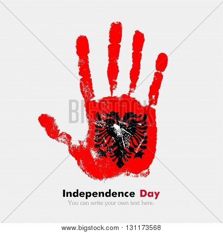 Hand print, which bears the flag of Albania. Independence Day. Grunge style. Grungy hand print with the flag. Hand print and five fingers. Used as an icon, card, greeting, printed materials.