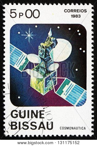 GUINEA-BISSAU - CIRCA 1983: a stamp printed in Guinea-Bissau shows Telecommunications Satellite circa 1983