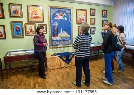 TORZHOK RUSSIA - MAY 02 2016: Museum Torzhok gold embroidery factory. The guide tells about the traditions of the local folk art and shows embroidered icons