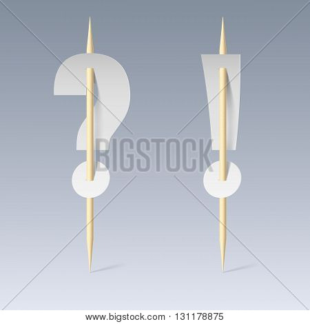 White paper cut font on toothpicks on grey background. Question and exclamation marks