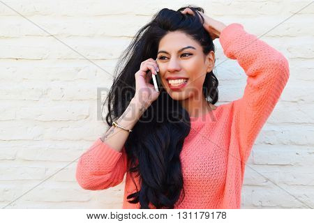 Young Latin Woman Talking On The Phone