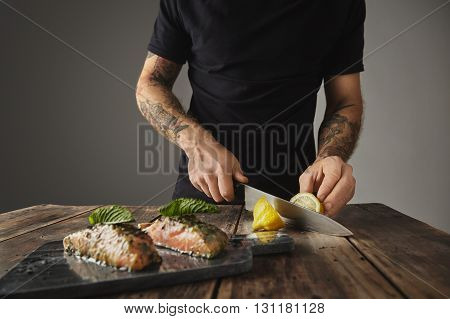 Man Cooks Healthy Meal, Cut Limon Behind Decorated With Mint Leaf Two Raw Pieces Of Salmon In White