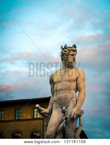 THe statue of neptune in the city of Florence