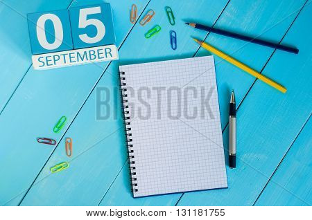 September 5th. Image of september 5 wooden color calendar on white background workplace. Autumn day.