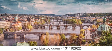 Prague, Czech Republic bridges skyline with historic Charles Bridge and Vltava river in the afternoon. Vintage