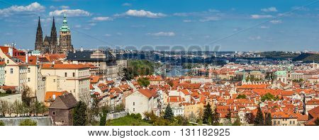 Prague, Czech Republic skyline panorama. St. Vitus Cathedral over old town red roofs.