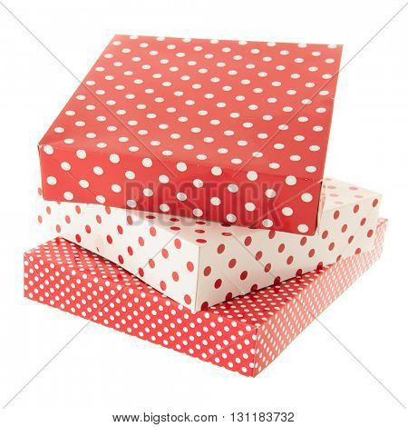 Stacked red dotted gifts isolated over white background
