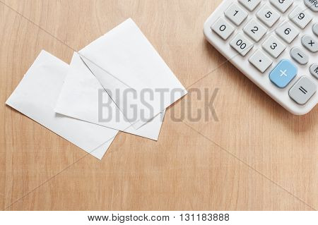 Bill and calculator on wooden table, Bill for income and expenditure with copy space