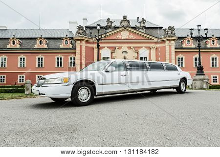 DOBRIS CZE - MAY 20, 2016: White limousine Lincoln Town Car before Chateau Dobris