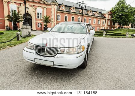 DOBRIS CZE - MAY 20 2016: White limousine Lincoln Town Car before Chateau Dobris