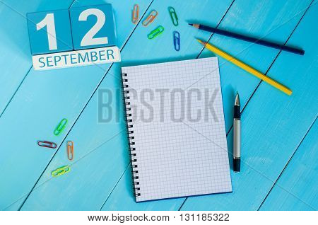September 12th. Image of september 12 wooden color calendar on white background. Autumn day. Empty space for text.