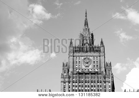 MOSCOW, RUSSIA - May 23, 2016: Building of Russian Foreign Ministry in Moscow background of blue sky with clouds. Black and white.
