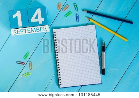 September 14th. Image of september 14 wooden color calendar on white background. Autumn day. Empty space for text.