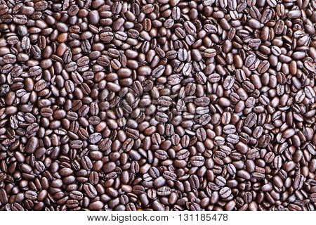 Background made from overhead view of coffee beans spread across a surface