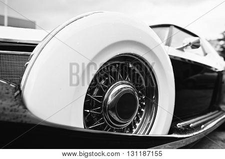 Vintage Wheel At Retro Car. Black And White Photo